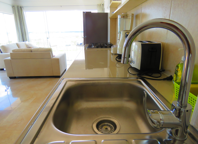 Penthouse kitchen and living, Boulevard 251 Iquitos